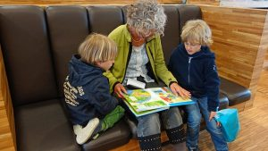 grandmother reading to her grand children